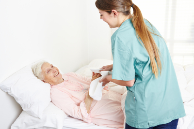 caregiver helping senior woman