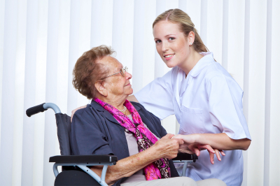 A nurse and an old women in a wheelchair