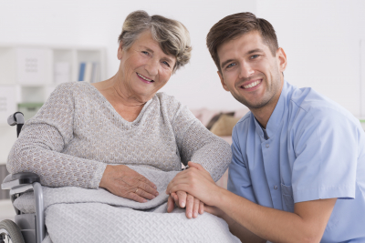 male nurse and elderly woman smiling